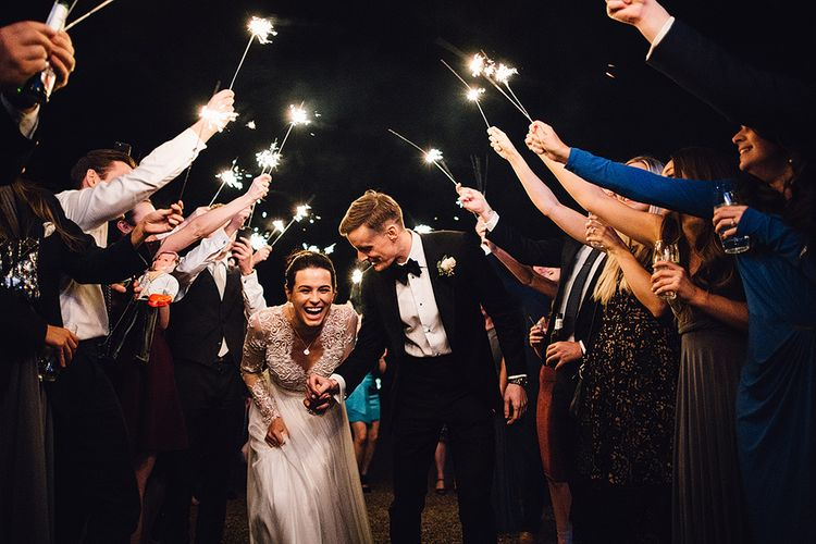 Sparkler Moment with Bride in Camellia Suzanne Neville Gown & Groom in SuitSupply Tuxedo