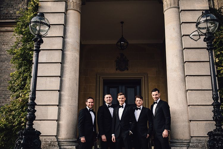 Groomsmen in Black Suitsupply Tuxedos
