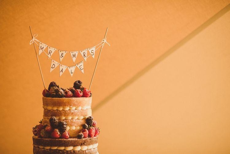 Naked Sponge Wedding Cake with Mini Bunting Topper | PapaKåta Tipi at Angrove Park North Yorkshire | Matt Penberthy Photography