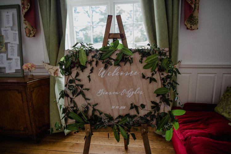 Wood Floral Garland Wedding Sign | Woodland Themed Wedding at Achnagairn Estate near Inverness, Scotland | Zoe Alexander Photography