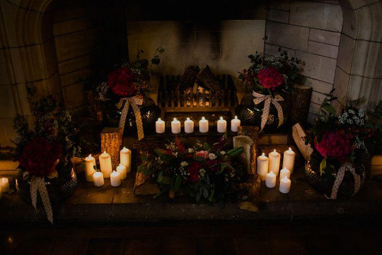 Church Candles & Red Flower Decor | Woodland Themed Wedding at Achnagairn Estate near Inverness, Scotland | Zoe Alexander Photography