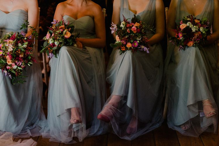 Bridesmaids in Blue Jenny Yoo Chiffon Dresses | Red Bouquets | Woodland Themed Wedding at Achnagairn Estate near Inverness, Scotland | Zoe Alexander Photography