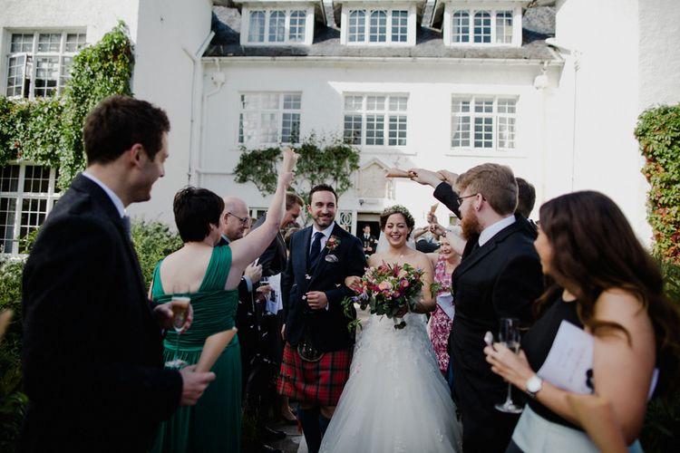 Confetti Exit | Bride in Modeca Bridal Gown | Groom in Tartan Kilt | Woodland Themed Wedding at Achnagairn Estate near Inverness, Scotland | Zoe Alexander Photography