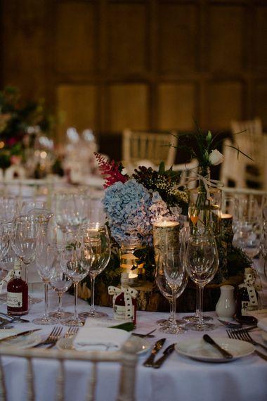Tree Stump & Floral Centrepiece | Woodland Themed Wedding at Achnagairn Estate near Inverness, Scotland | Zoe Alexander Photography