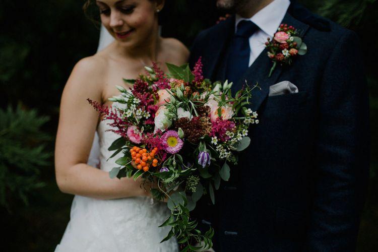 Red Bridal Bouquet | Bride in Modeca Bridal Gown | Groom in Tartan Kilt | Woodland Themed Wedding at Achnagairn Estate near Inverness, Scotland | Zoe Alexander Photography