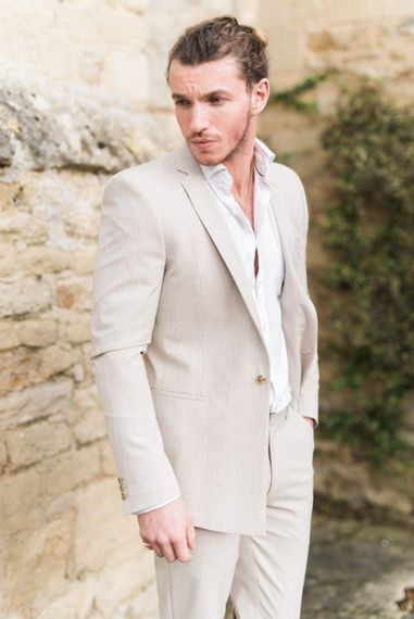 Groom in Light Beige Linen Suit | Romantic Blush Wedding Inspiration by The Wedding Stylist at Notley Abbey with Joanna Truby Flowers | Emma Pilkington Photography | Opaline Films
