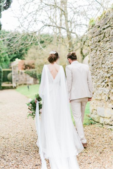 Bride in Cherry Williams Gown | Groom in Beige Suit | Romantic Blush Wedding Inspiration by The Wedding Stylist at Notley Abbey with Joanna Truby Flowers | Emma Pilkington Photography | Opaline Films
