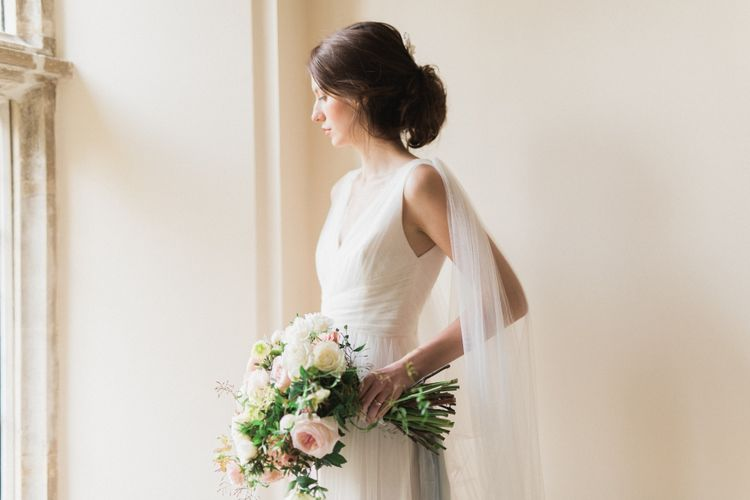 Bride in Cherry Williams Gown | Romantic Blush Wedding Inspiration by The Wedding Stylist at Notley Abbey with Joanna Truby Flowers | Emma Pilkington Photography | Opaline Films
