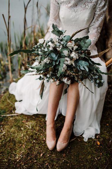 Winter Bouquet | Eucalyptus | Succulents | Pheasant Feather | Boho Bride in Shikoba Bride Wedding Dress | Boho Winter Tipi Wedding Inspiration | Styling & Concept by Pretty Creative | Amy Faith Photography