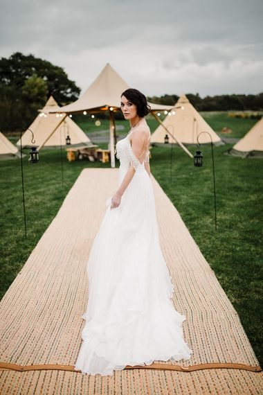 Tipi by All About Me Marquees | Boho Bride in Shikoba Bride Wedding Dress | Boho Winter Tipi Wedding Inspiration | Styling & Concept by Pretty Creative | Amy Faith PhotographyBoho Winter Tipi Wedding Pretty Creative Amy Faith Photography_0121_0