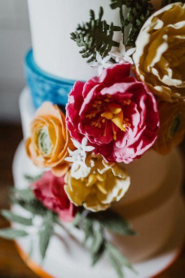 Brightly Coloured Wedding Cake With Sugar Flowers