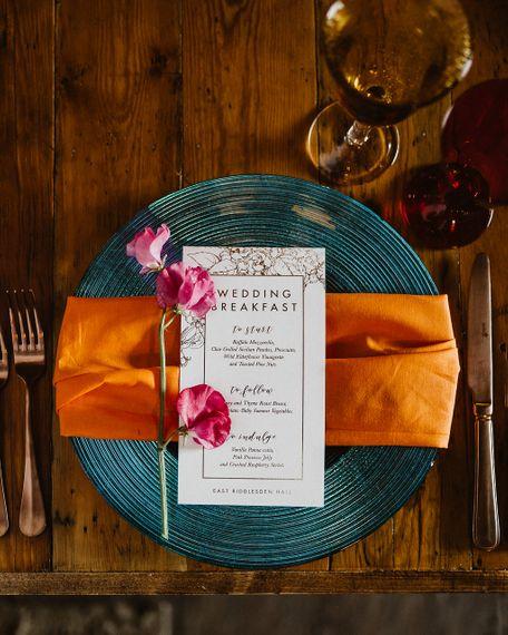 Bold Place Setting With Orange Napkin