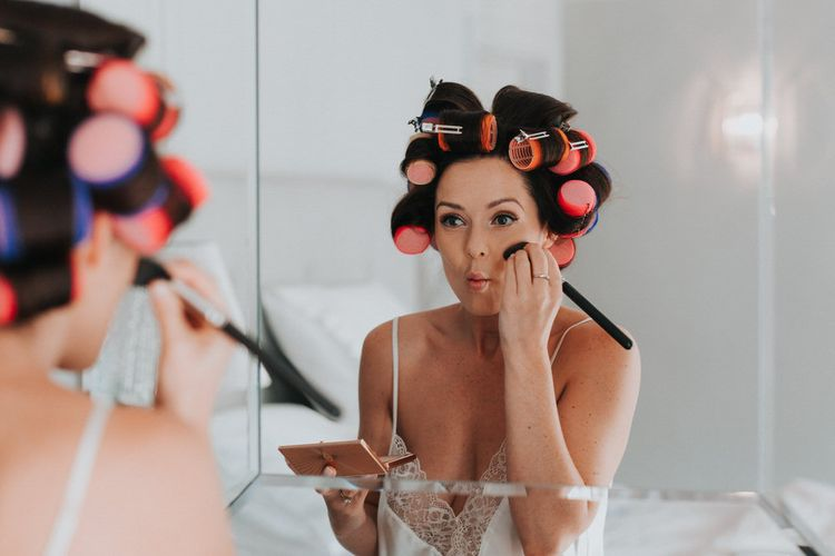 Bride Getting Ready For Wedding With Hair Rollers