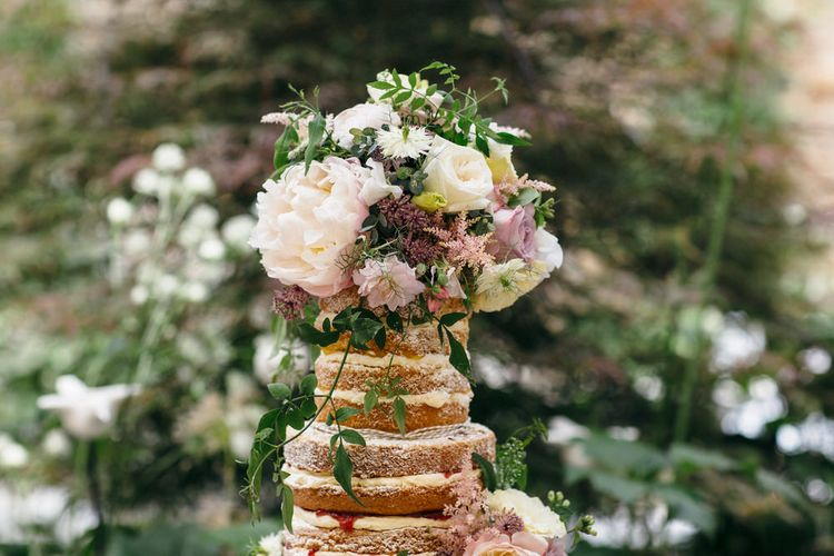 Naked Wedding Cake Covered In Flowers