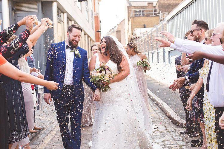 Confetti Shot   Bride in Lace Oleg Cassini Wedding Dress from Davids Bridal   Groom in River Island Suit   Kirsty Mackenzie Photography   Insta Wedding Films