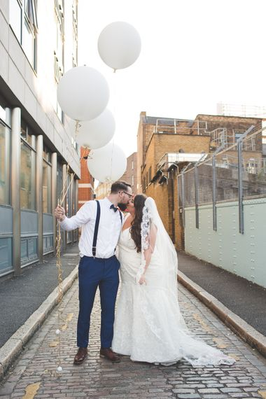 Giant Balloons   Bride in Lace Oleg Cassini Wedding Dress from Davids Bridal   Groom in River Island Suit   Kirsty Mackenzie Photography   Insta Wedding Films