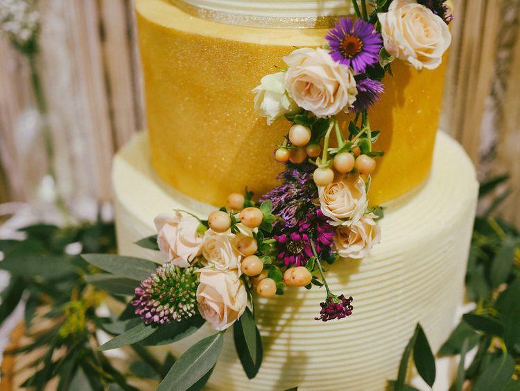 Gold Wedding Cake With Fresh Flowers