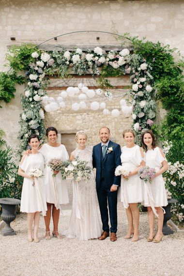Bridesmaids In White Reiss Dresses
