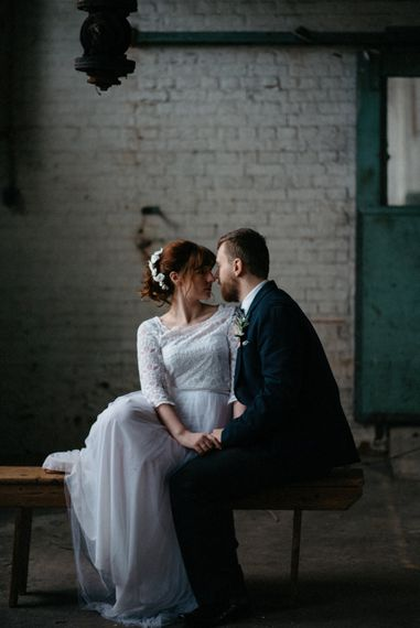Industrial Candlelit Winter Wedding Inspiration | Eliza Tootsweet Bridal Gown | Delicate Flowers | Flower Intallation | Sophia Veres Photography
