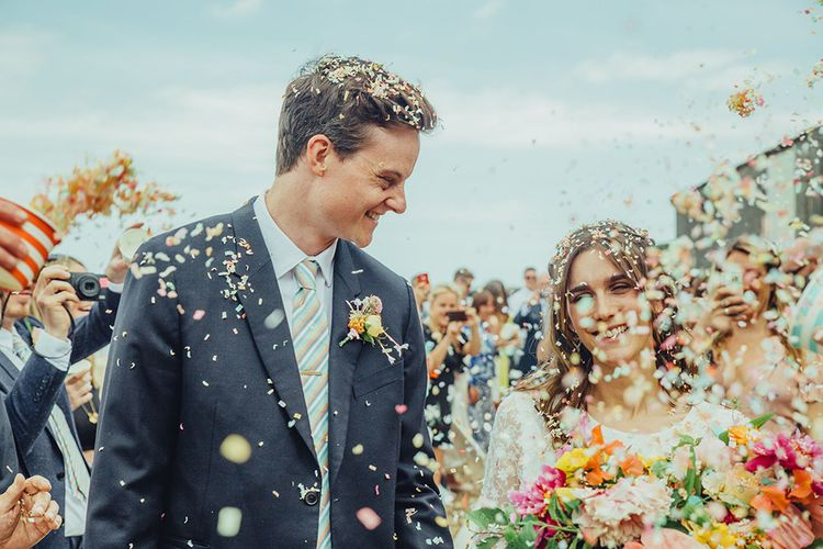 Confetti Moment | Bride in Elizabeth Avey Bridal Gown | Groom in Paul Smith Suit | Bright Coastal Wedding at East Quay Venue in Whitstable | Deborah Grace Photography