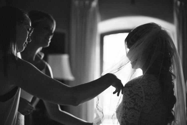 Bride & Bridesmaids Getting Ready For Wedding