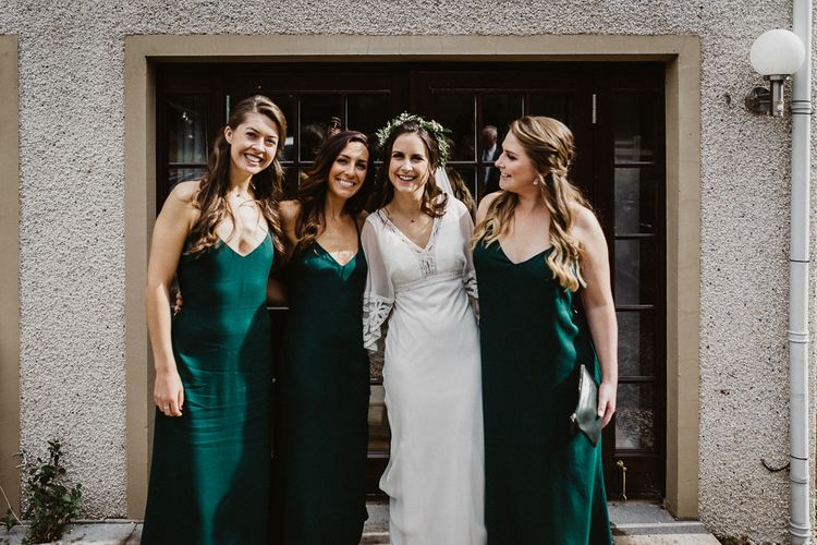 Bridesmaids in Forest Reformation Dresses | Bride in Eliza Jane Howell Gown from Gillian Million Boutique | Rustic Wedding at Barn at Barr Castle, Scotland | Caitlin + Jones Photography & Film