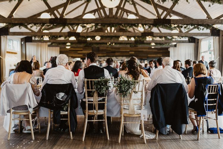 Barn Reception | Greenery Chair Back Decor | Rustic Wedding at Barn at Barr Castle, Scotland | Caitlin + Jones Photography & Film