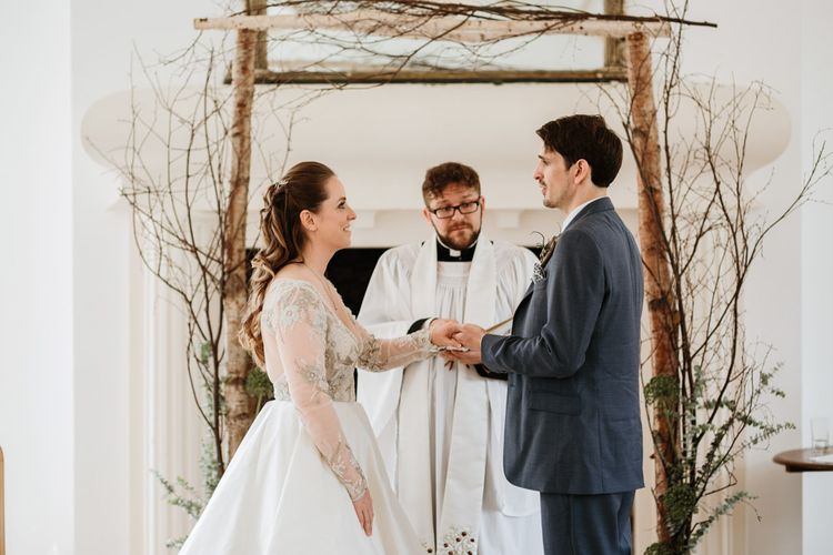 Wedding Ceremony | Driftwood, Brach Altar Wedding Decor | Bride in Miss Hayley Paige Bridal Gown | Groom in Navy Ted Baker Suit | Natural Wedding at Northbrook Park, Surrey | Green Antlers Photography | Gione Da Silva Film