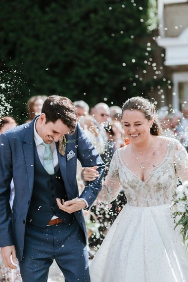 Confetti Exit | Bride in Miss Hayley Paige Bridal Gown | Groom in Navy Ted Baker Suit | Natural Wedding at Northbrook Park, Surrey | Green Antlers Photography | Gione Da Silva Film