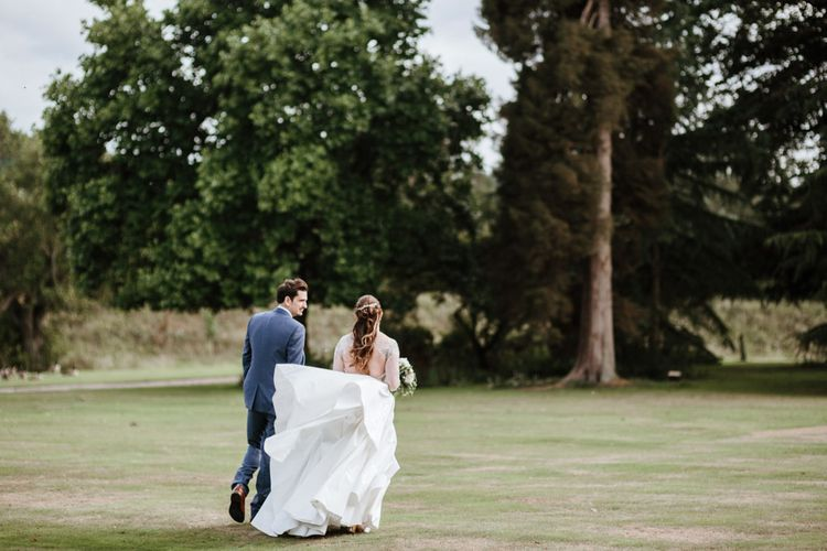 Bride in Miss Hayley Paige Bridal Gown | Groom in Navy Ted Baker Suit | Natural Wedding at Northbrook Park, Surrey | Green Antlers Photography | Gione Da Silva Film