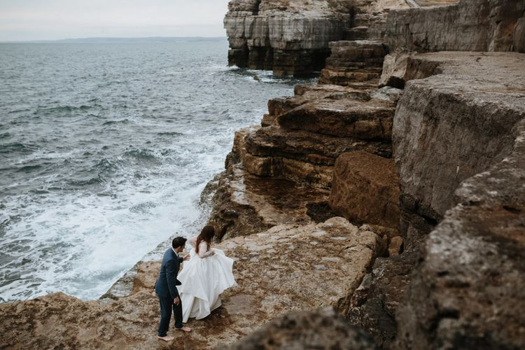 After Wedding Portraits at Portland Bill, Dorset | Bride in Miss Hayley Paige Bridal Gown | Groom in Navy Ted Baker Suit | Green Antlers Photography | Gione Da Silva Film