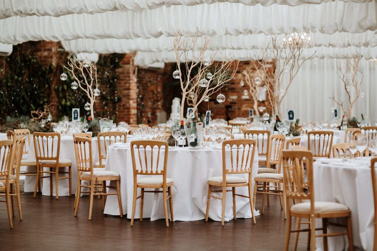 Wedding Reception with Driftwood & Succulents Centrepiece | Natural Wedding at Northbrook Park, Surrey | Green Antlers Photography | Gione Da Silva Film
