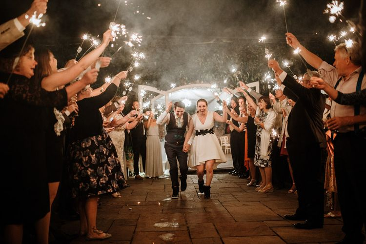 Sparkler Exit | Bride in Miss Hayley Paige Bridal Gown | Groom in Navy Ted Baker Suit | Natural Wedding at Northbrook Park, Surrey | Green Antlers Photography | Gione Da Silva Film