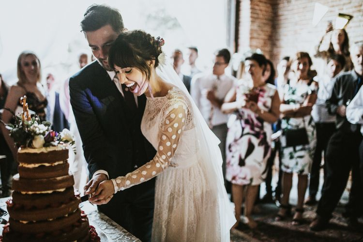 Cutting The Cake | Bride in Katya Katya Gown | Groom in Ted Baker Suit | Fishley Hall Rustic Barn Wedding | Darina Stoda Photography