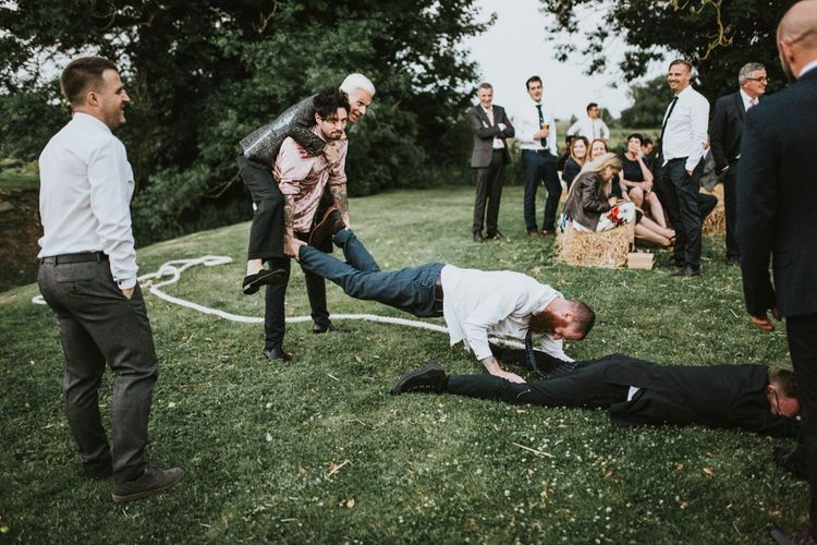 Tug of War | Fishley Hall Rustic Barn Wedding | Darina Stoda Photography