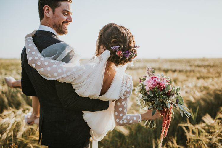 Bridal Up Do with Flowers | Katya Katya Gown | Groom in Ted Baker Suit | Fishley Hall Rustic Barn Wedding | Darina Stoda Photography