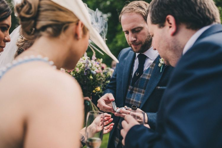 Preston Court Wedding With Bride In Sassi Holford & Groom In Checked Suit By Jack Bunneys With Images From Claire Penn Photography