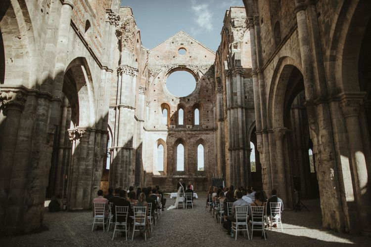 Ruin Abbey Wedding Ceremony In Tuscany // Elegant Destination Wedding In Tuscany At San Galgano Abbey With Bride In Bespoke Dress By Madame Paulette With Images From James Frost Photography
