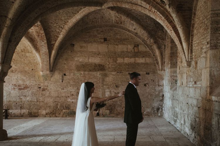 First Look At Wedding // Elegant Destination Wedding In Tuscany At San Galgano Abbey With Bride In Bespoke Dress By Madame Paulette With Images From James Frost Photography