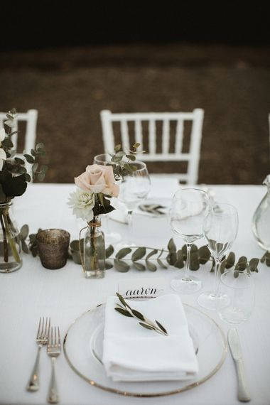 White Linen, Pink & Green Flowers With Olive Branches For Wedding Decor // Elegant Destination Wedding In Tuscany At San Galgano Abbey With Bride In Bespoke Dress By Madame Paulette With Images From James Frost Photography
