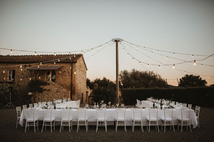 Festoon Lit Wedding Breakfast In Italy // Elegant Destination Wedding In Tuscany At San Galgano Abbey With Bride In Bespoke Dress By Madame Paulette With Images From James Frost Photography
