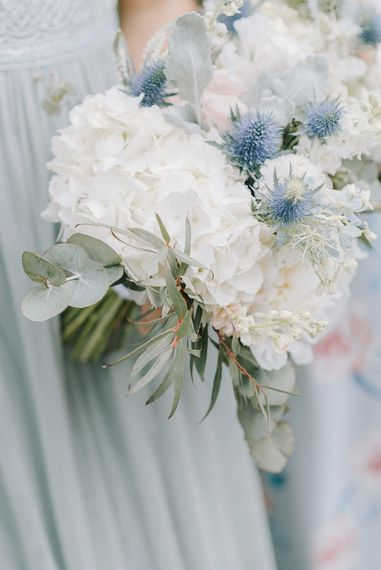 White Hydrangea & Thistle Bouquet | Classic Blue & White Wedding at Prestwold Hall in Loughborough | Georgina Harrison Photography