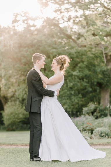 Bride in Dee Hutton Wedding Dress | Groom in Black Tuxedo | Classic Blue & White Wedding at Prestwold Hall in Loughborough | Georgina Harrison Photography