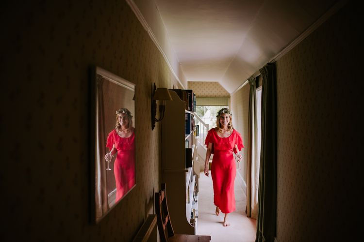 Bridesmaid in Red Reformation Dress | Bright Festival Themed At Home Wedding in a Tipi | McGivern Photography