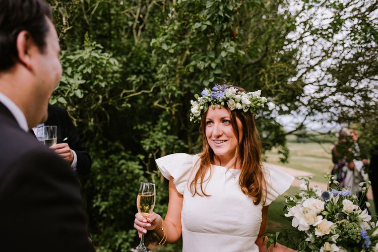 Bride in Floral Crown | Bright Festival Themed At Home Wedding in a Tipi | McGivern Photography