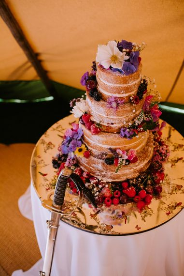 Naked Wedding Cake with Fruit Decor | Bright Festival Themed At Home Wedding in a Tipi | McGivern Photography