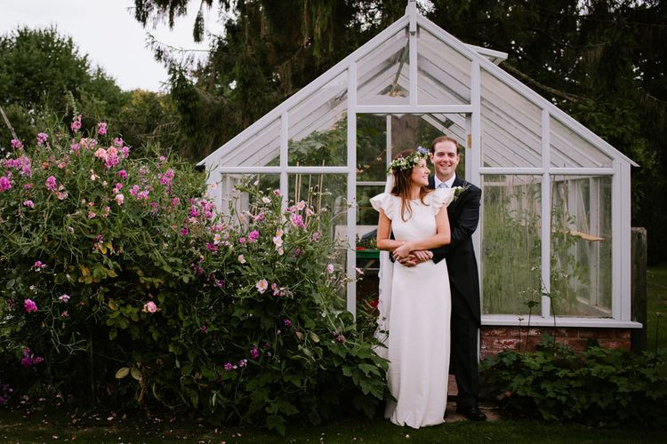Bride & Groom Glasshouse Portrait | Bright Festival Themed At Home Wedding in a Tipi | McGivern Photography