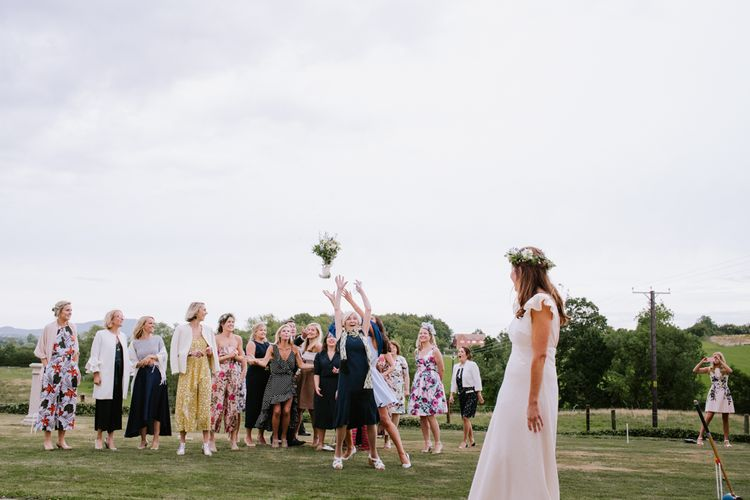 Bouquet Toss | Bright Festival Themed At Home Wedding in a Tipi | McGivern Photography