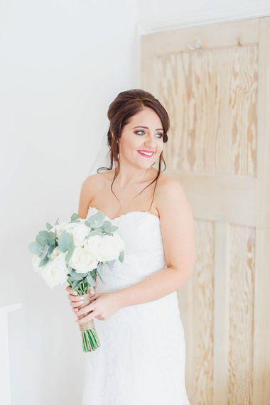 Bride in sweetheart neckline wedding dress