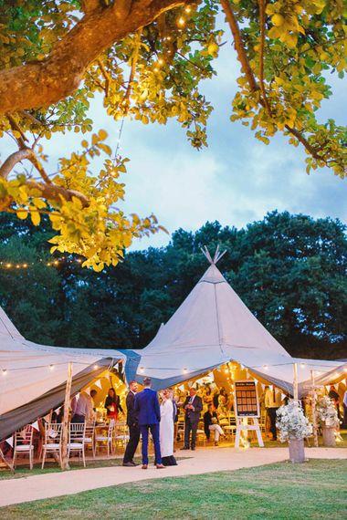 Outdoor Tipi Reception with Festoon Lights
